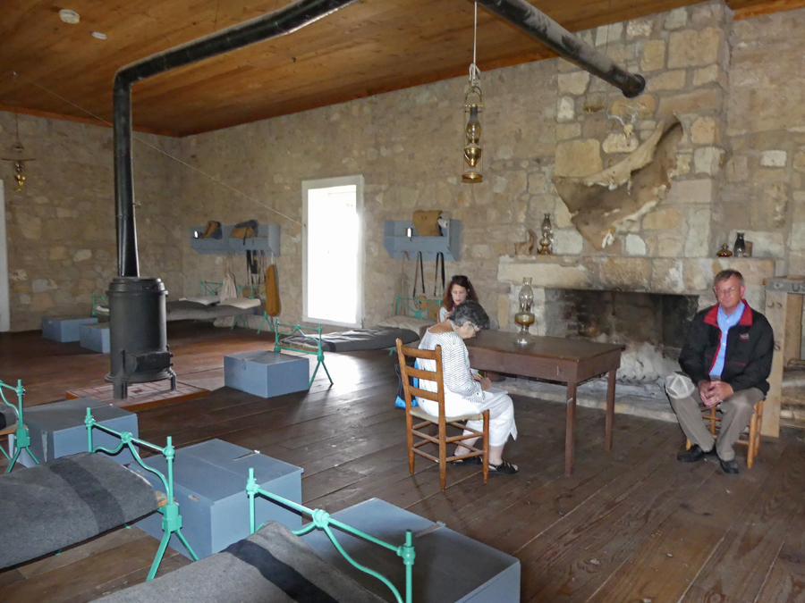 Bob Bluthardt explains the furnishings of a barracks at Fort Concho