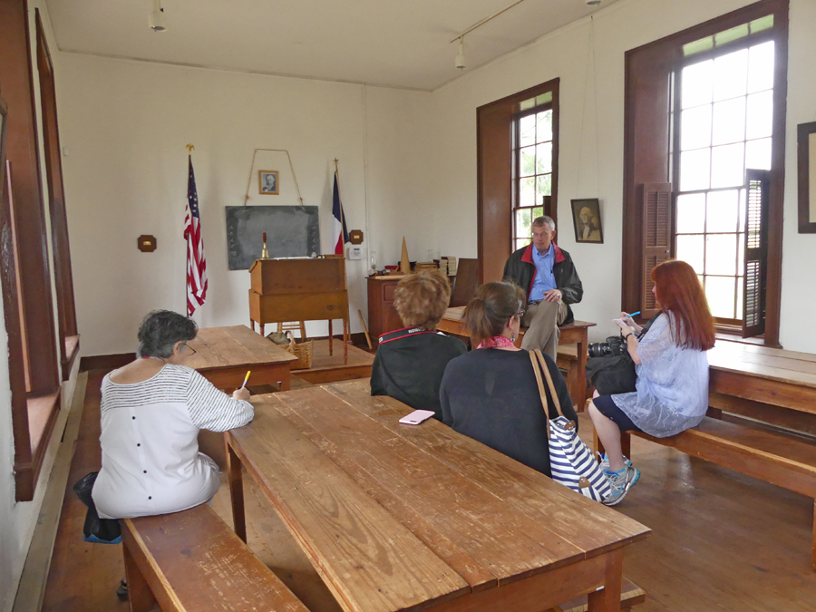The chapel/schoolroom  at Fort Concho with peopel sitting in it
