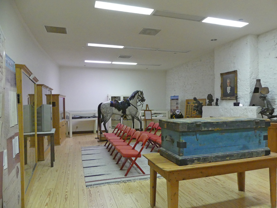 Exhibits at the Vistors Center at Fort Concho including horse and field chest
