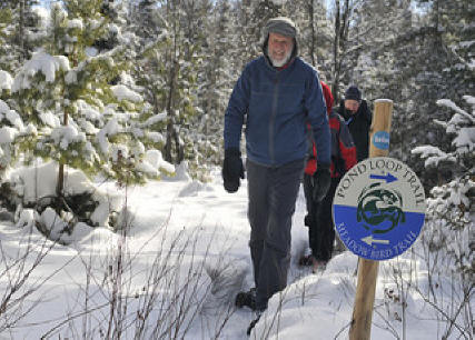 Man hiking in snow  at Wild Center in Adirondacks