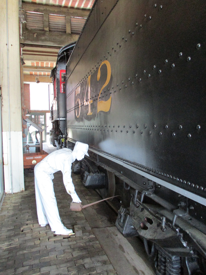 """ghost"" preforming maintainence on train"