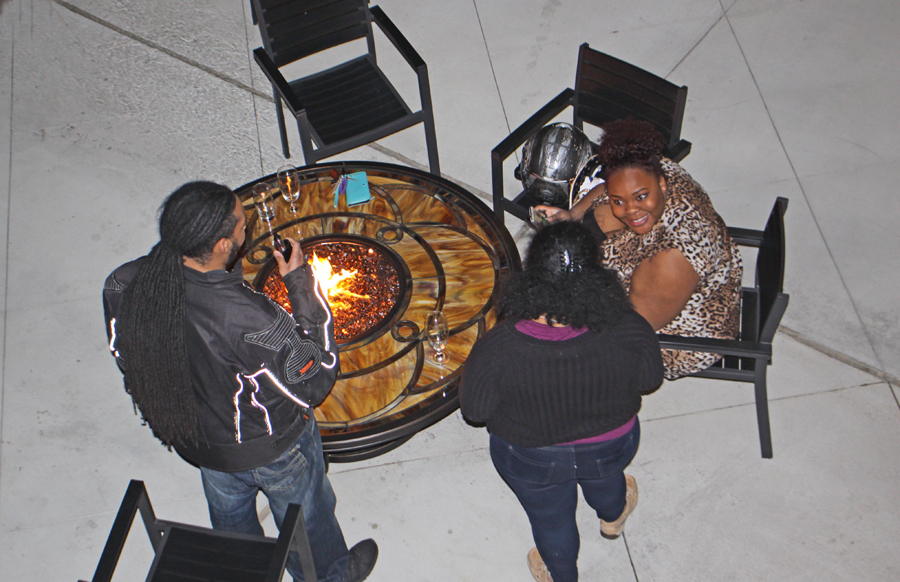 family gathered aroudn a firepit at the Deison in Tallahassee
