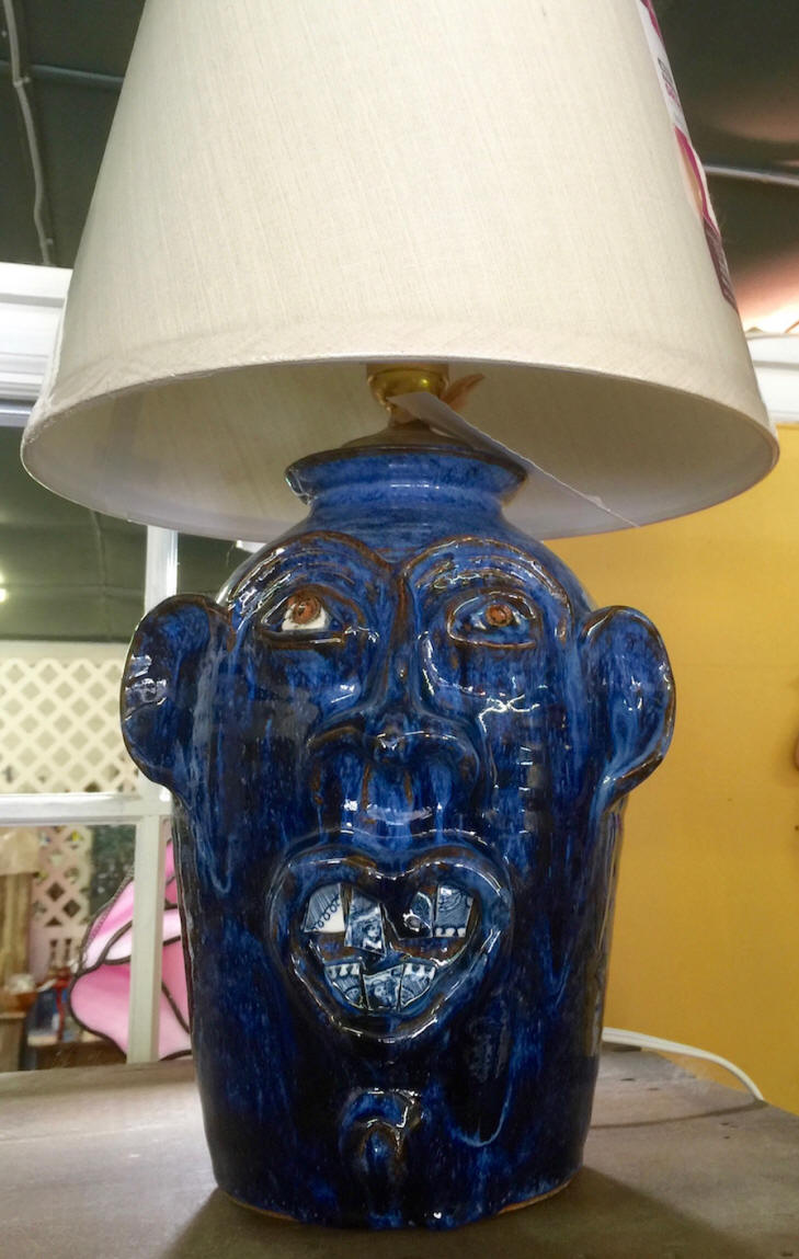 Face jug pottery lamp in Little Red Barn in Throughbred County, SC