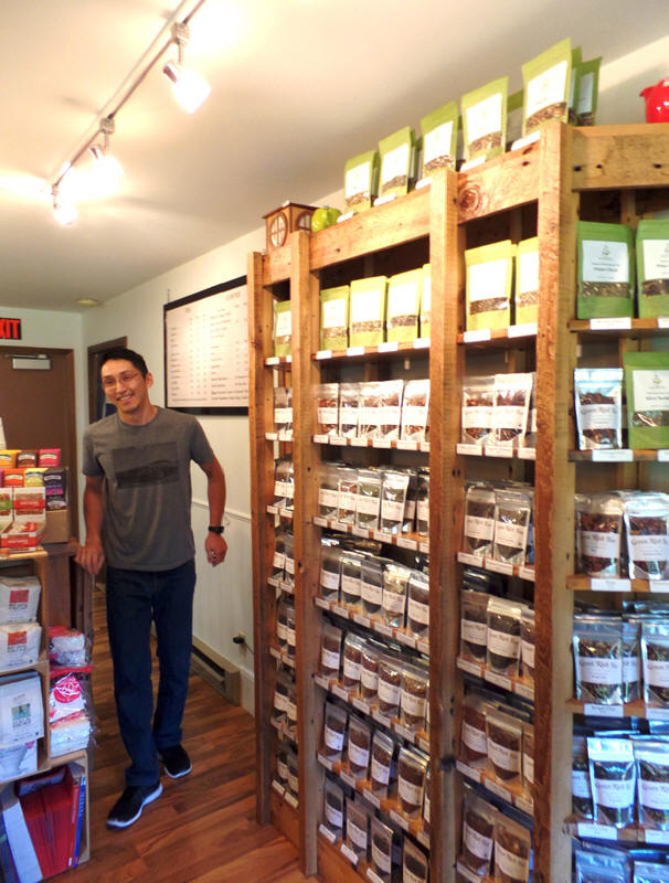 Clerk behind counter at Green Rich Tea  in wisconsin