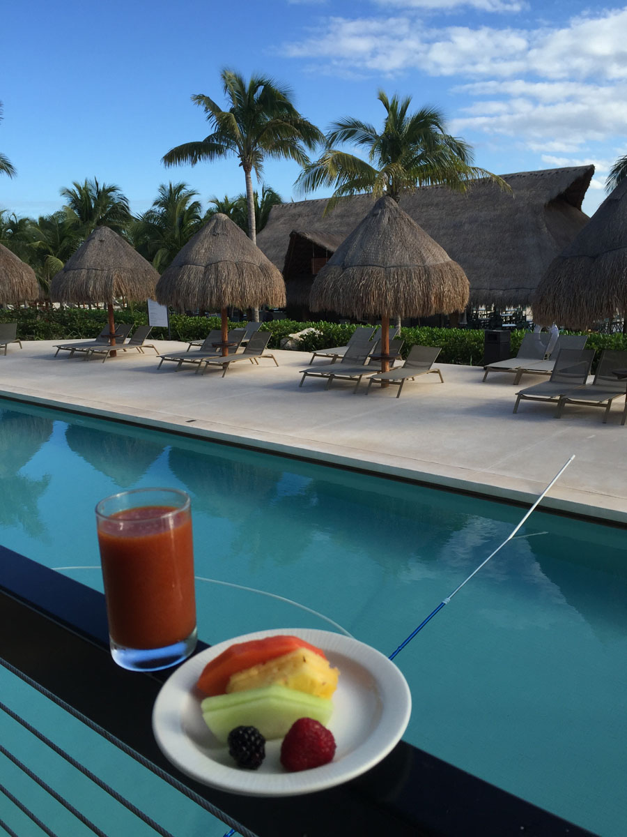 thath umbrellas  and breakfast at poolside at Excellence Resort