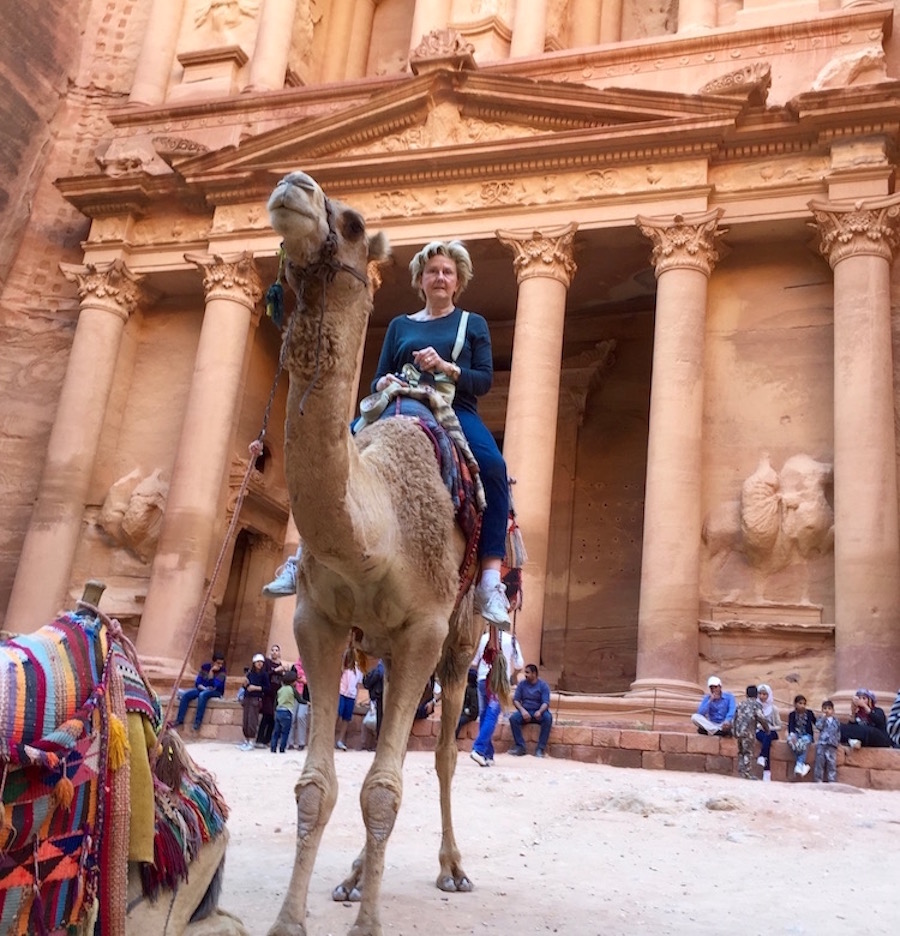 Author on camel in front of Treasury in Petra, Jordan