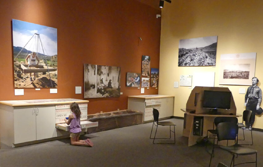 Little girl looking at exhibits at Anasazi Heritage Center