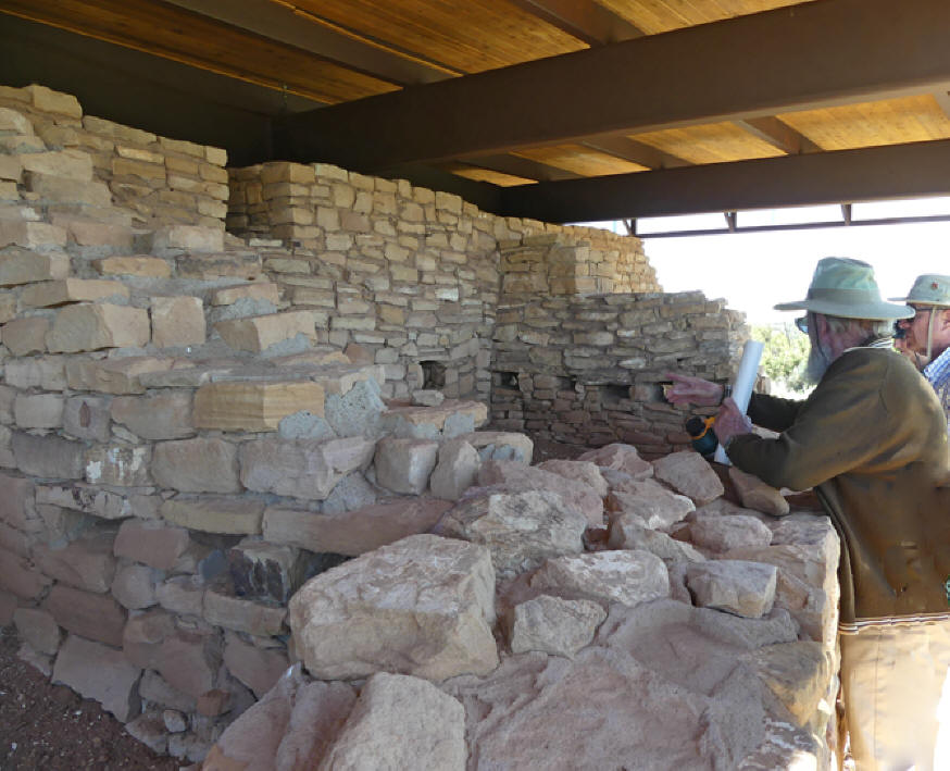 man explains features in a room of the Great House at Lowry Pueblo in Canyon of the Ancients