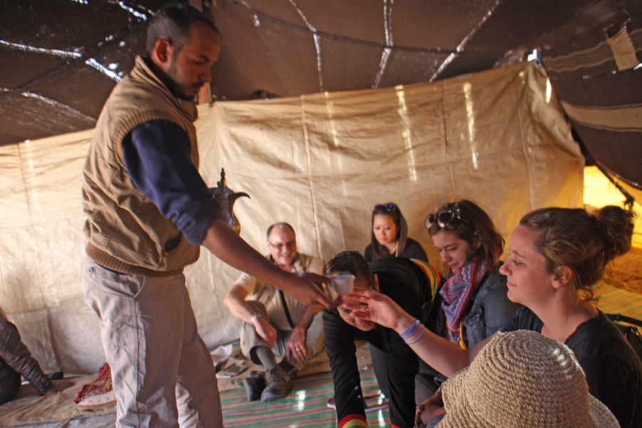 Drinking coffee in a Bedouin tent at Wadi Feynan