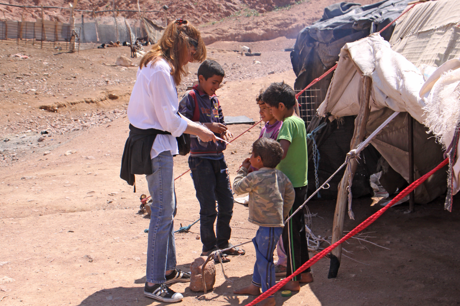 Woman showing Bedouin children something