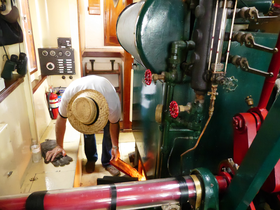 Captain stokes the boiler on the Tule princess