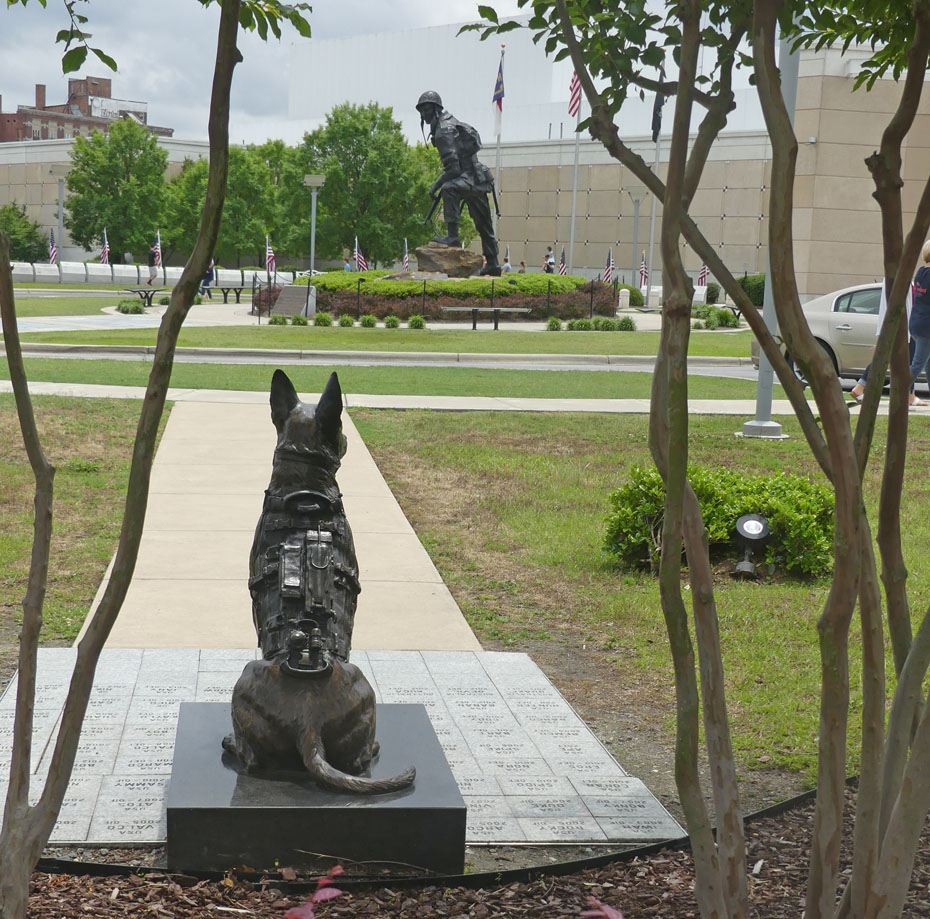 Stature of k9 dog and soldier at entrance to Fort Bragg's 82nd Airbourne Musuem