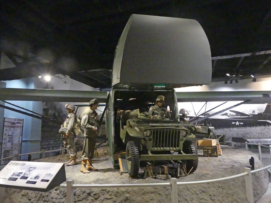 exhibit showing a glider unloading a jeep WWII era