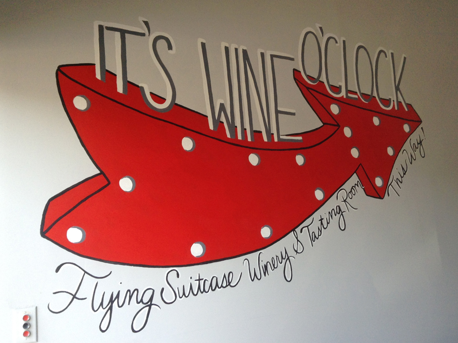 colorful arrow point with text It's Wine o:clock and Flying Suitcase Winery