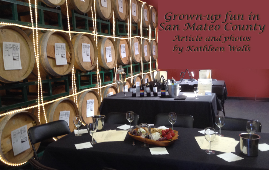 image of tables set with food and wine agains a backgroudn of wine barrels used as header for Grown up Fun in San Mateo County
